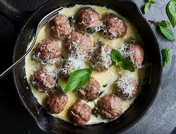 Italian meatballs in a pan with cream